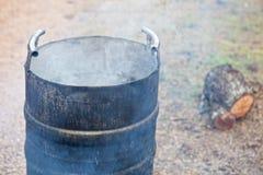 Smoking scalding pot Stock Photo