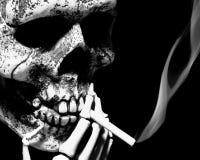 Smoking skull. Skeleton smokes a cigarette, isolated on black Royalty Free Stock Photo