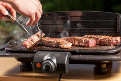 Smoking steak Stock Images