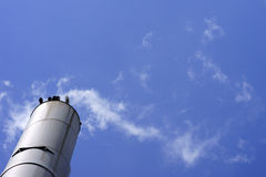 Smoking steel chimney Stock Photo