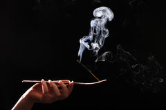 Smoking stick in the woman`s hand Royalty Free Stock Photo