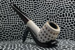 Smoking tobacco pipe billiards. Meerschaum sea foam mineral sepiolite. Biliard smoking tobacco pipe made from sea foam Meershaum mineral sepiolite against the Royalty Free Stock Images