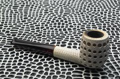Smoking tobacco pipe billiards. Turkish meerschaum sea foam sepiolite. Biliard smoking tobacco pipe made from sea foam Meershaum mineral sepiolite against the Royalty Free Stock Photos