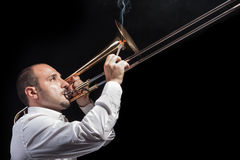 Smoking with a trombone Royalty Free Stock Image