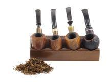 smoking Tubos y tabaco de madera Imágenes de archivo libres de regalías