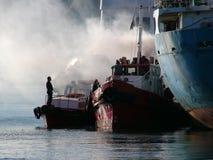Smoking Tug. Engine repairs in harbor Stock Photo