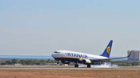 Smoking Tyres On Ryanair Passenger Plane Aircraft Landing Alicante airport Royalty Free Stock Photos