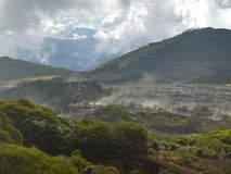 The smoking valley of volcanoes Stock Image