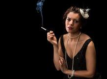 Smoking vintage woman Stock Photo
