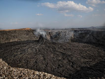 Smoking volcanic pinnacle close to Erta Ale volcano, Ethiopia Royalty Free Stock Photos