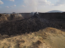 Smoking volcanic pinnacle close to Erta Ale volcano, Ethiopia Royalty Free Stock Photo
