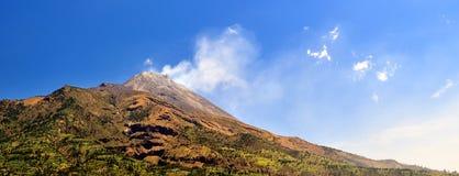 Smoking volcano of Merapi at sunrise. Central Java, Indonesia royalty free stock image