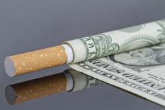 Smoking is a waste of money Stock Photos