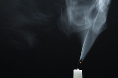 Smoking white candel Royalty Free Stock Photography
