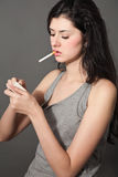 Smoking woman Stock Photography