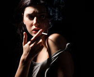 Smoking woman Stock Images