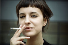 Smoking woman Royalty Free Stock Image