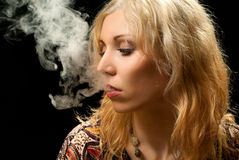 Smoking woman. Stock Image