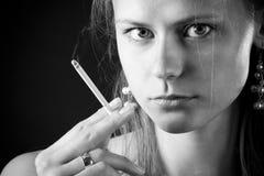 Smoking woman Royalty Free Stock Images