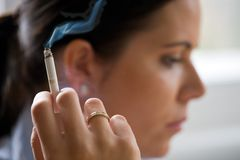 Smoking woman with a cigare Stock Images