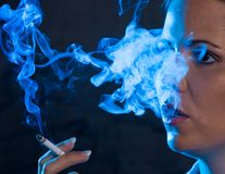 Smoking woman with a cigare Stock Image