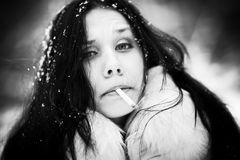 Smoking woman portrait Stock Photography