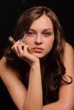 Smoking woman Stock Images