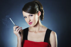Smoking woman in red Royalty Free Stock Images