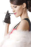 Smoking woman sideview Royalty Free Stock Image