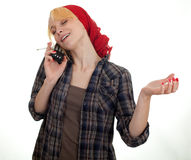 Smoking woman speaks by phone Stock Image