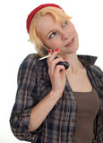 Smoking woman speaks by phone Stock Photography