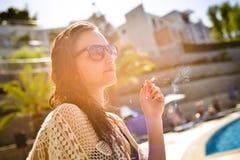 Smoking Woman with sun glasses. Royalty Free Stock Photo