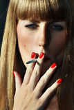 Smoking women with red lipstick lips Stock Image