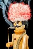 Smoking wooden man Stock Images