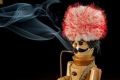 Smoking wooden man Stock Image