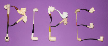 Smoking. The word PIPE made with meerschaum pipes Stock Image