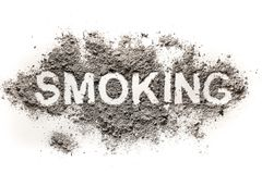 Smoking word written in ash or dust royalty free stock photo
