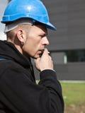 Smoking worker in hard hat Stock Photos