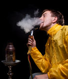 Smoking in yellow Royalty Free Stock Photography