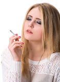 Smoking young girl Stock Photos