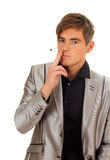 Smoking young handsome man Stock Photography
