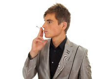 Smoking young handsome man Royalty Free Stock Photos
