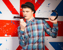 Smoking Young Man with Cane on his Shoulder Stock Photo