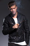 Smoking young man in leather jacket Stock Photo