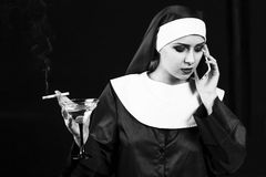 Smoking young nun Royalty Free Stock Images