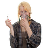 Smoking young woman with inhale mask Royalty Free Stock Photos