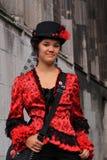 smokingowa czerwona kobieta Fotografia Stock