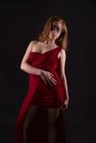 smokingowa elegancka czerwona kobieta Obrazy Stock