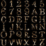 Smoky alphabet. Letters and numbers from smoke on a black background Royalty Free Stock Images