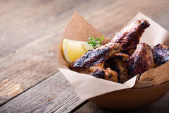 Smoky barbecued chicken wings Stock Images